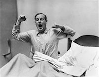 1930s MAN IN BED WAKING UP YAWNING AND STRETCHING Stock Photo - Premium Rights-Managednull, Code: 846-06112474