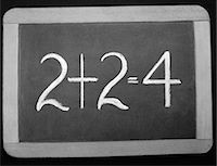 1940s SMALL WOODEN-FRAMED CHALKBOARD READING 2+2=4 Stock Photo - Premium Rights-Managednull, Code: 846-06112490