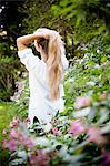 Woman standing in flower bushes Stock Photo - Premium Royalty-Free, Artist: Christina Krutz, Code: 649-06112531