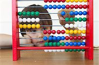 Boy playing with abacus Stock Photo - Premium Royalty-Freenull, Code: 649-06112570