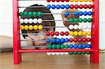 Boy playing with abacus Stock Photo - Premium Royalty-Free, Artist: ableimages, Code: 649-06112570