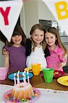 Smiling girls hugging at birthday party Stock Photo - Premium Royalty-Free, Artist: ableimages, Code: 649-06112593