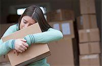 sad girls - Teenage girl hugging cardboard box Stock Photo - Premium Royalty-Freenull, Code: 649-06112653