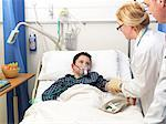 Doctor examining patient in hospital Stock Photo - Premium Royalty-Free, Artist: Steve Craft, Code: 649-06112714