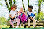 Children playing dress up outdoors Stock Photo - Premium Royalty-Free, Artist: GreatStock, Code: 649-06112824