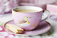 food - Close up of cup of tea and cookie Stock Photo - Premium Royalty-Freenull, Code: 649-06112841