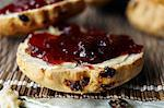 Close up of sliced scone with jam Stock Photo - Premium Royalty-Free, Artist: Cultura RM, Code: 649-06112844