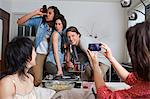 Friends taking pictures of themselves Stock Photo - Premium Royalty-Free, Artist: Cultura RM, Code: 649-06112962