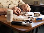 Older man measuring out medication Stock Photo - Premium Royalty-Free, Artist: ableimages, Code: 649-06113089
