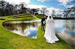 Newlywed couple walking on grassy bridge Stock Photo - Premium Royalty-Free, Artist: Cultura RM, Code: 649-06113099