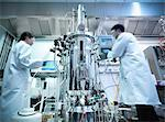 Scientists working with equipment in lab Stock Photo - Premium Royalty-Free, Artist: Blend Images, Code: 649-06113281