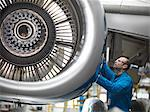 Worker examining airplane engine Stock Photo - Premium Royalty-Free, Artist: Andrew Kolb, Code: 649-06113326