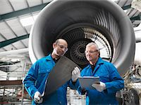 Workers talking in airplane hangar Stock Photo - Premium Royalty-Freenull, Code: 649-06113328