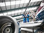 Workers examining airplane in hangar Stock Photo - Premium Royalty-Free, Artist: Blend Images, Code: 649-06113333
