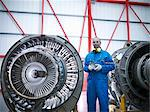 Worker standing by airplane engines Stock Photo - Premium Royalty-Free, Artist: Andrew Kolb, Code: 649-06113349