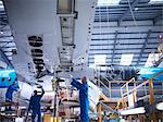 Workers examining airplane machinery Stock Photo - Premium Royalty-Free, Artist: CulturaRM, Code: 649-06113350