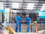 Workers examining airplane machinery Stock Photo - Premium Royalty-Free, Artist: Andrew Kolb, Code: 649-06113357