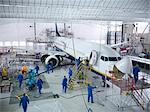 Workers in airplane hangar Stock Photo - Premium Royalty-Free, Artist: Blend Images, Code: 649-06113360