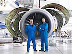 Workers standing by airplane engine Stock Photo - Premium Royalty-Free, Artist: Blend Images, Code: 649-06113361