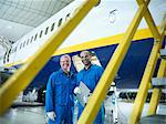 Workers talking in airplane hangar Stock Photo - Premium Royalty-Free, Artist: CulturaRM, Code: 649-06113374