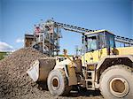 Digger scooping pile of stones in quarry Stock Photo - Premium Royalty-Free, Artist: Albert Normandin, Code: 649-06113384