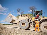 Workers talking on digger in quarry Stock Photo - Premium Royalty-Free, Artist: Blend Images, Code: 649-06113395