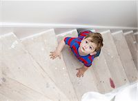 Toddler boy climbing steps Stock Photo - Premium Royalty-Freenull, Code: 649-06113424