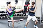 Boxer training with coach in gym Stock Photo - Premium Royalty-Free, Artist: Christina Handley, Code: 649-06113449