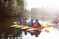 Teacher talking to students in kayaks Stock Photo - Premium Royalty-Freenull, Code: 649-06113542