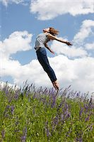 scenic and spring (season) - Woman jumping over tall grass Stock Photo - Premium Royalty-Freenull, Code: 649-06113575