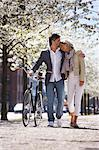 Couple walking bicycle in park Stock Photo - Premium Royalty-Free, Artist: urbanlip.com, Code: 649-06113631