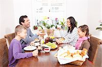 family table eating together - Family eating breakfast at table Stock Photo - Premium Royalty-Freenull, Code: 649-06113820