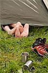 Feet peeking out of camp tent Stock Photo - Premium Royalty-Free, Artist: Robert Harding Images, Code: 649-06113909