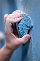 Close up of a climbers hand on an artificial handhold at a climbers gym Stock Photo - Premium Royalty-Freenull, Code: 649-06113913