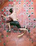 Man climbing indoor rock wall Stock Photo - Premium Royalty-Free, Artist: Cultura RM, Code: 649-06113915