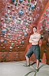 Climber standing by indoor rock wall Stock Photo - Premium Royalty-Free, Artist: Cultura RM, Code: 649-06113917