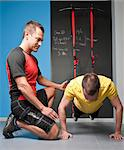 Trainer working with client in gym Stock Photo - Premium Royalty-Free, Artist: Robert Harding Images, Code: 649-06113947