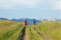 Young athletic couple jogging in mountains Stock Photo - Premium Royalty-Freenull, Code: 6106-06114379