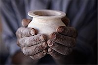Two hands holdiong an Alabaster vase. Stock Photo - Premium Royalty-Freenull, Code: 6106-06114552