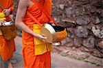 Lao morning ritual, Monks carrying bowls Stock Photo - Premium Royalty-Free, Artist: Mark Downey, Code: 6106-06114726