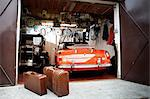 Vintage car and trunk suitcases in garage Stock Photo - Premium Royalty-Free, Artist: Blend Images, Code: 614-06116048