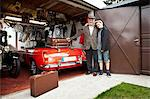 Grandfather and grandson with vintage car and trunk suitcases in garage Stock Photo - Premium Royalty-Free, Artist: Transtock, Code: 614-06116051