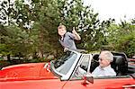 Grandfather and grandson driving in vintage car Stock Photo - Premium Royalty-Free, Artist: Blend Images, Code: 614-06116055