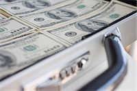 Briefcase with 100 dollar banknotes Stock Photo - Premium Royalty-Freenull, Code: 614-06116066