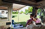 Mature woman reading in camper van Stock Photo - Premium Royalty-Free, Artist: Cultura RM, Code: 614-06116105