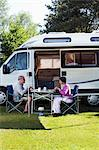 Couple eating breakfast outside campervan Stock Photo - Premium Royalty-Free, Artist: Ascent Xmedia, Code: 614-06116109