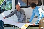 Couple looking at map outside campervan Stock Photo - Premium Royalty-Free, Artist: Cultura RM, Code: 614-06116114