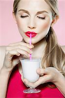 sucking - Young woman drinking milk shake Stock Photo - Premium Royalty-Freenull, Code: 614-06116235