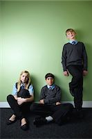 Three surly school children looking at camera Stock Photo - Premium Royalty-Freenull, Code: 614-06116430