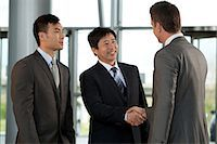 Multiracial businessmen shaking hands Stock Photo - Premium Royalty-Freenull, Code: 614-06116471